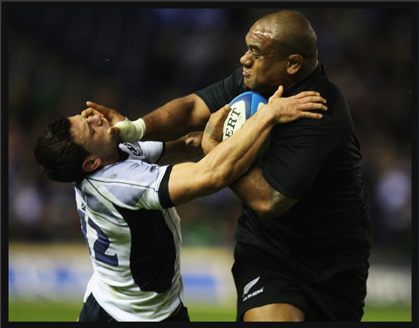 An All Black crushes some hapless opponent (photo from nzherald.co.nz)